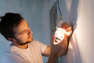 Electrician Looking at Light Bulb